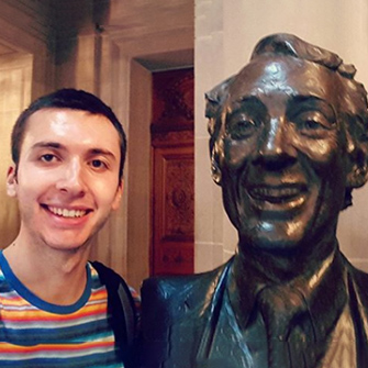 David Ottenheimer with a statue of Harvey Milk in San Francisco City Hall.