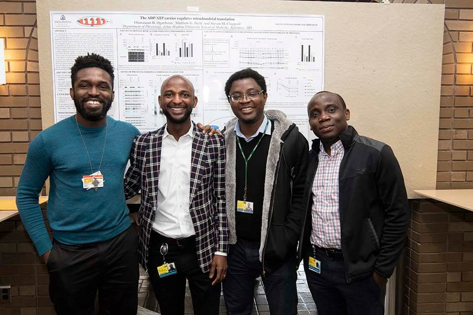 Young Investigators' Day winners display their research in a poster session.