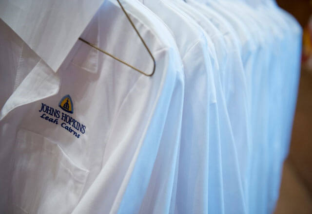 White coats hanging on a rack.