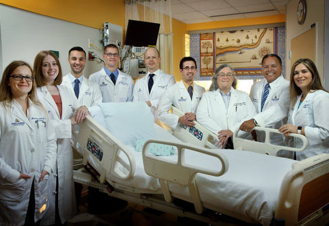 department posing by a hospital bed