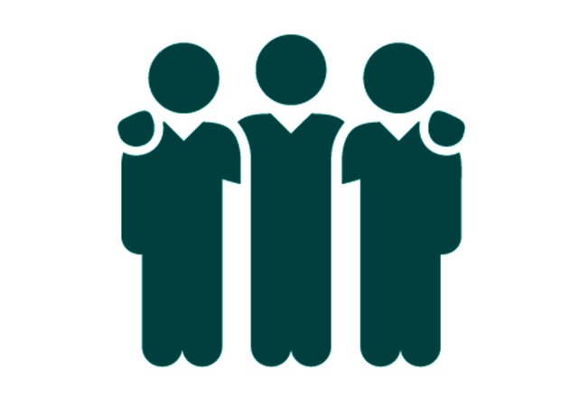Silhouette of a group of people standing together.