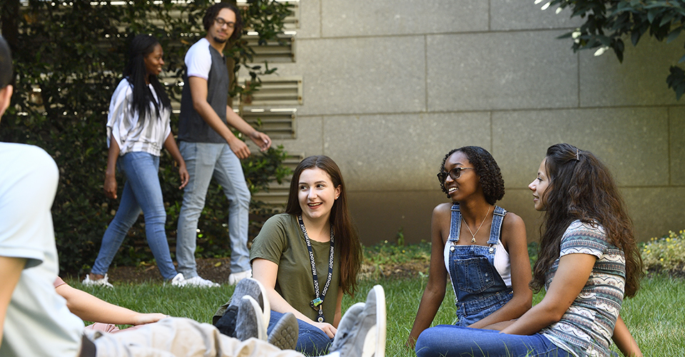 students sitting on the graduate student lawn