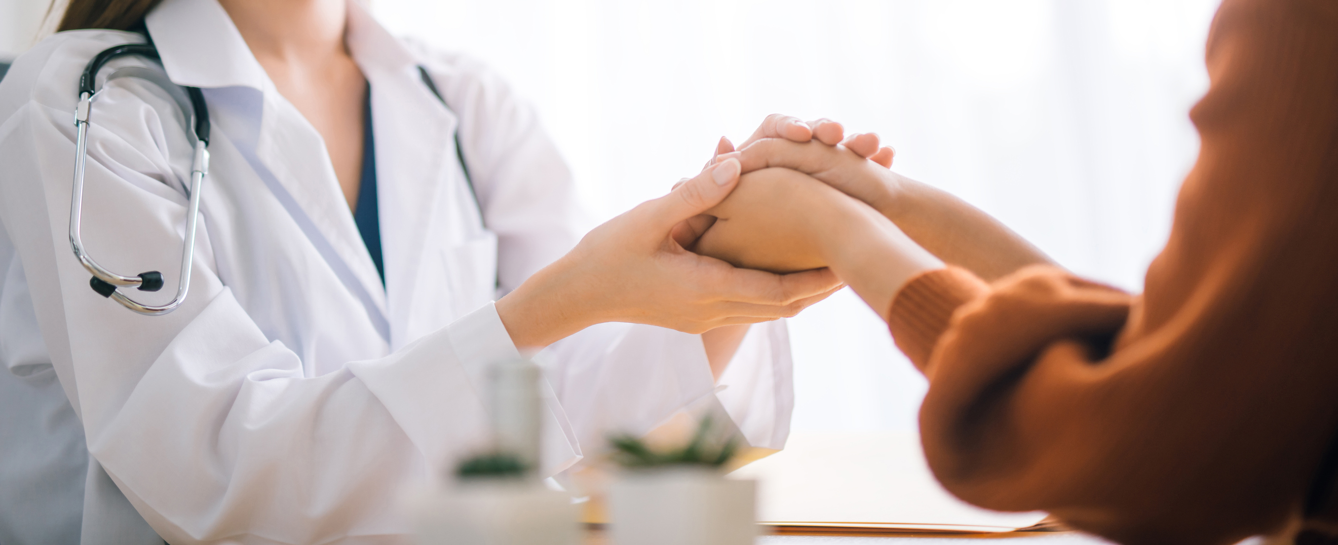 doctor holding patient's hand - memorial gift surgery