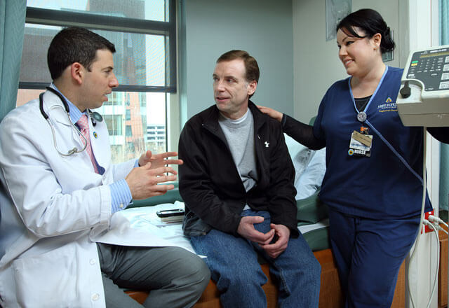johns hopkins surgery - doctor and nurse talking to patient in exam room