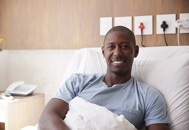 johns hopkins surgery - man smiling in hospital bed