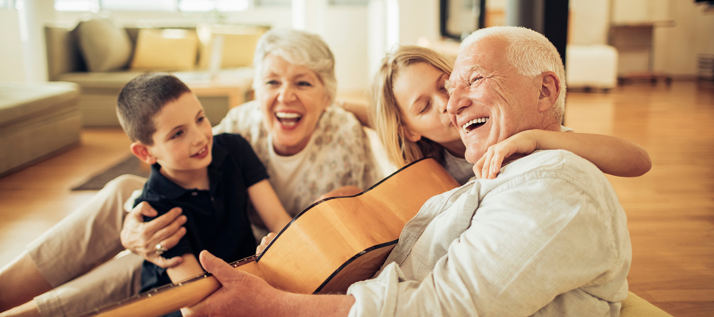 hepato-pancreato-biliary surgery hpb - mature man playing guitar with family