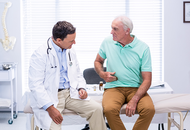 hepato-pancreato-biliary-surgery-hpb - patient explaining pain to doctor during exam