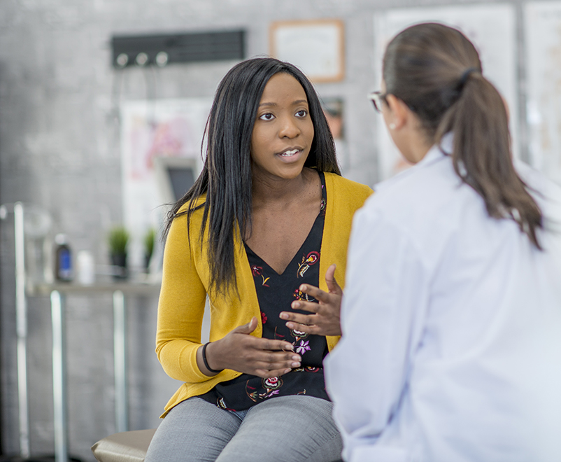 breast surgery - woman talking to doctor