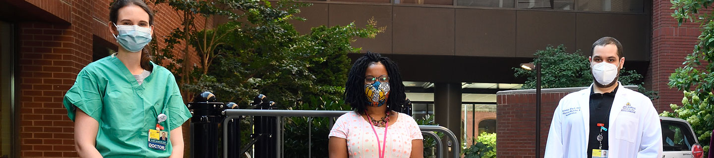 Clinical team wearing masks outside of The Johns Hopkins Hospital