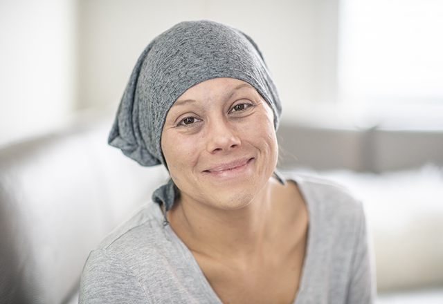 woman wearing scarf smiling