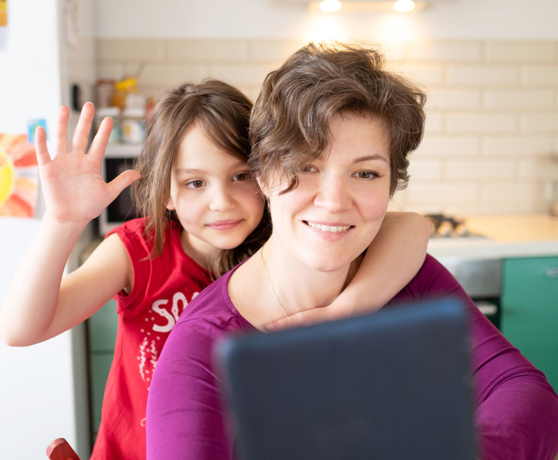 mother and daughter using tablet - pediatric transplant