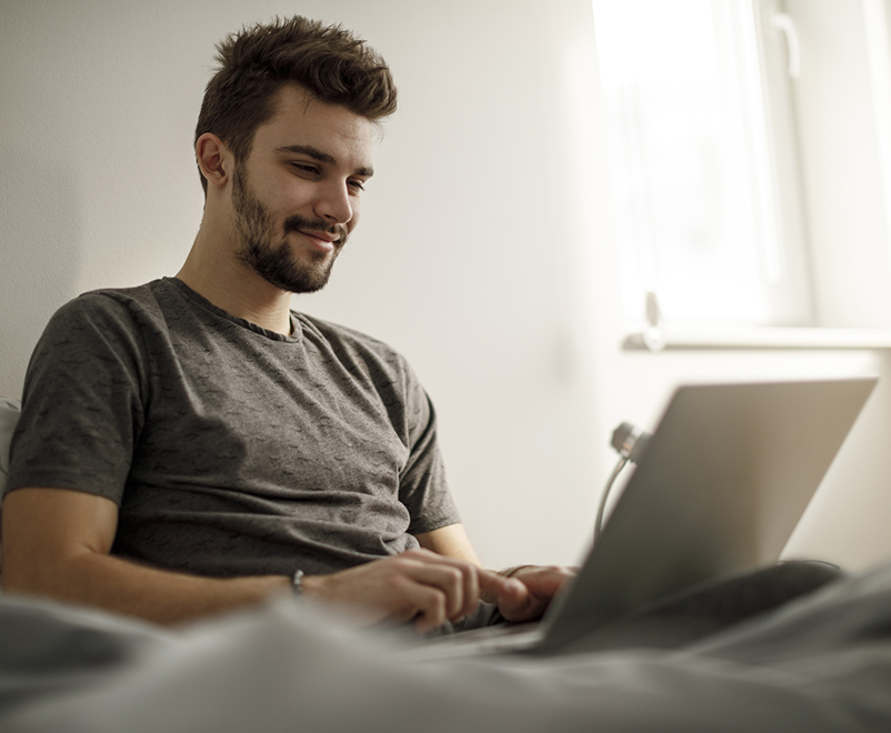 man in bed using laptop - auto islet transplant