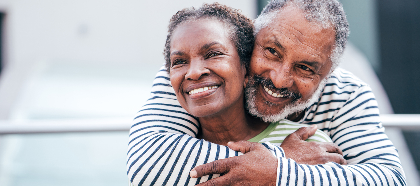 mature african american couple embrace