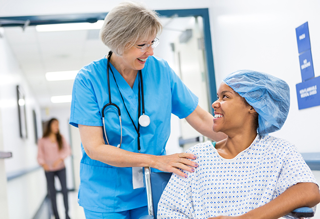 nurse smiling with patient