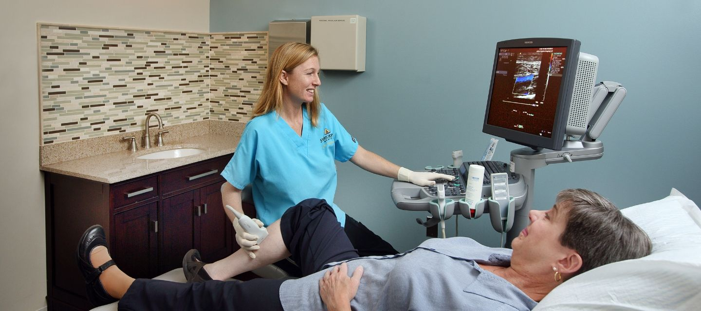 woman getting ultrasound on her knee