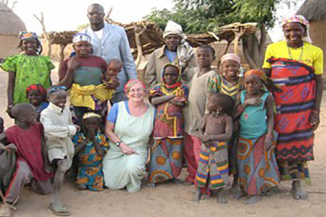 Dr. Sheila West in Africa with local residents