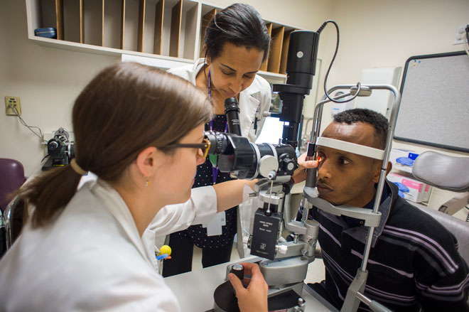 A resident works with a patient in the ophthalmology clinic