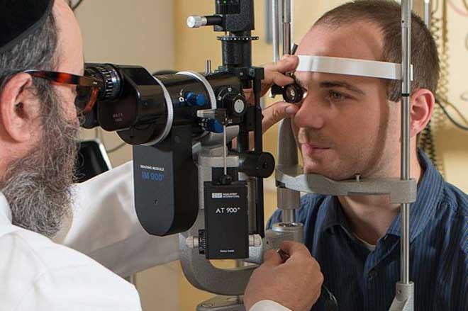 Dr. Eric Singman performing eye test