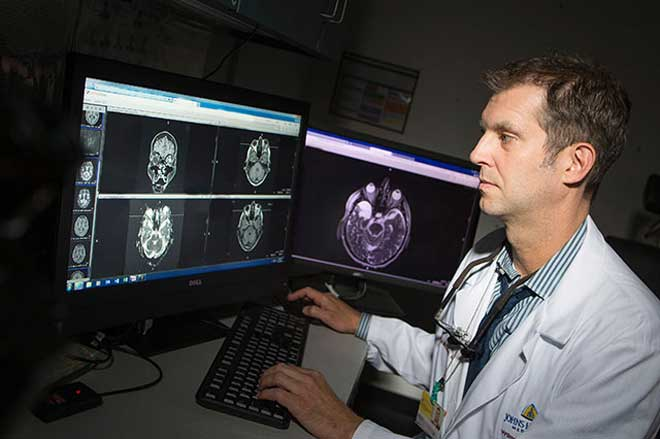 Dr. Tim McCulley looking at eye scans on computer
