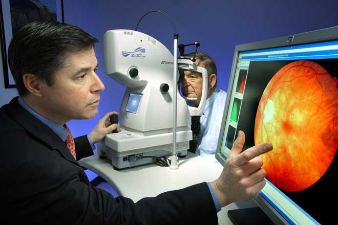 Dr. Neil Bressler looks at image of patient retina